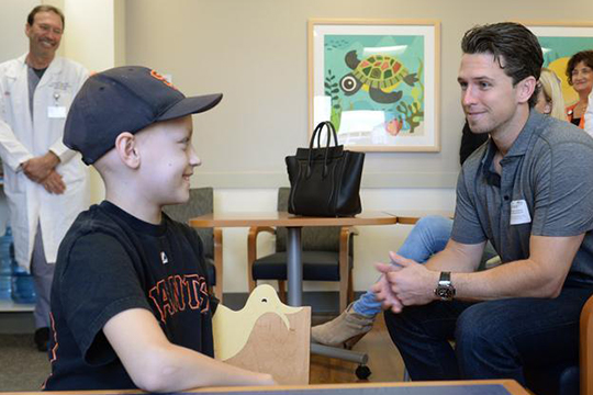 Giants' Buster Posey visits young cancer patients, giving hugs and leaving smiles in his wake